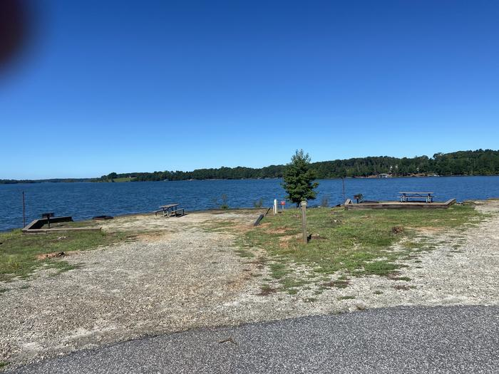 A photo of Site 34 of Loop SPRINGFIELD  at SPRINGFIELD with Picnic Table, Electricity Hookup, Fire Pit, Tent Pad, Waterfront, Lantern Pole, Water Hookup