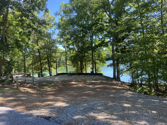 Double Site— A photo of Site 61 of Loop SPRINGFIELD  at SPRINGFIELD with Picnic Table, Electricity Hookup, Fire Pit, Shade, Tent Pad, Waterfront, Lantern Pole, Water Hookup