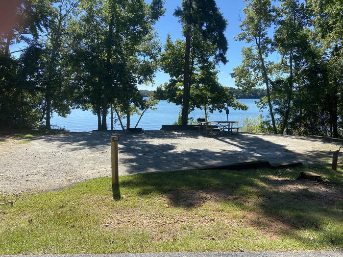 A photo of Site 52 of Loop SPRINGFIELD  at SPRINGFIELD with Picnic Table, Electricity Hookup, Fire Pit, Shade, Tent Pad, Waterfront, Lantern Pole, Water Hookup