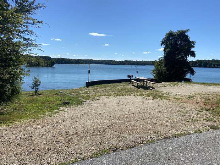 A photo of Site 57 of Loop SPRINGFIELD  at SPRINGFIELD with Picnic Table, Electricity Hookup, Fire Pit, Shade, Tent Pad, Waterfront, Lantern Pole, Water Hookup