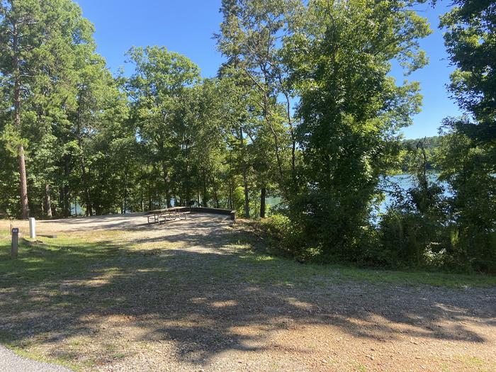 A photo of Site 60 of Loop SPRINGFIELD  at SPRINGFIELD with Picnic Table, Electricity Hookup, Fire Pit, Shade, Tent Pad, Waterfront, Lantern Pole, Water Hookup