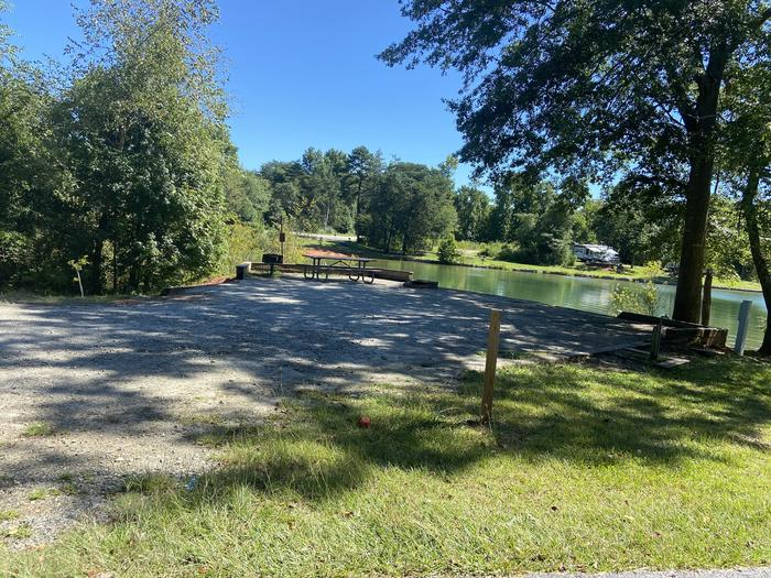A photo of Site 65 of Loop SPRINGFIELD  at SPRINGFIELD with Picnic Table, Electricity Hookup, Fire Pit, Shade, Tent Pad, Waterfront, Lantern Pole, Water Hookup