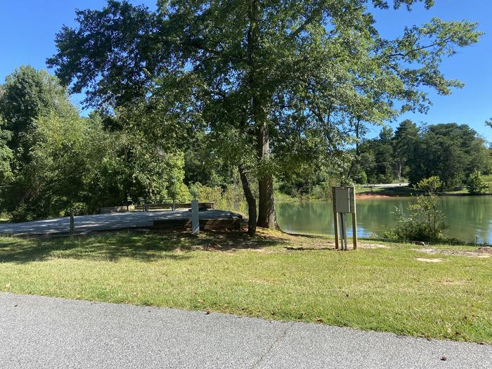 A photo of Site 65 of Loop SPRINGFIELD  at SPRINGFIELD with Picnic Table, Electricity Hookup, Shade, Tent Pad, Full Hookup, Waterfront, Lantern Pole, Water Hookup