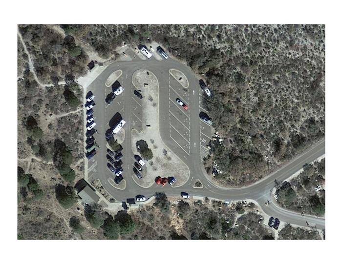 """View of the RV Campground and Pine Spring Trailhead parking via satellite.  The area is a large paved parking lot with sites delineated for """"RV Only"""".Satellite view of the Pine Spring RV Campground and trailhead parking area.  During the busy season this area becomes very congested."""
