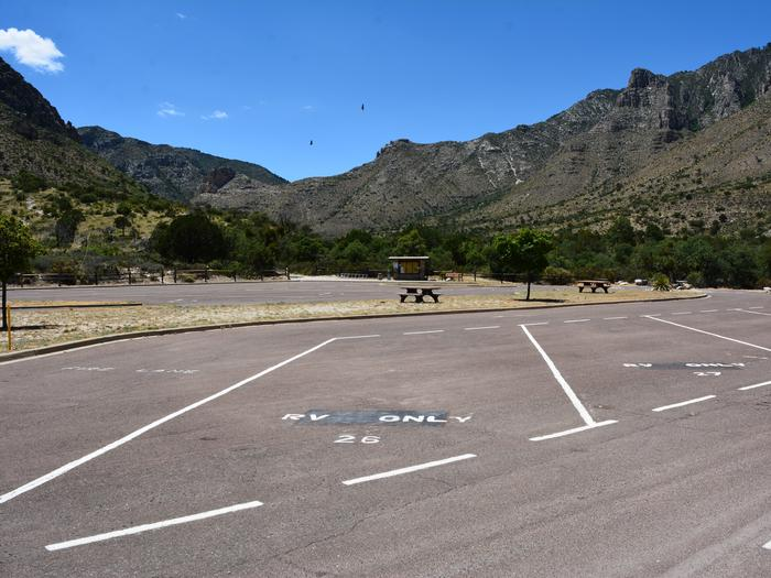 RV campsite 26 is a paved pull-through parking space.  This site has views of Pine Springs Canyon and surrounding Guadalupe Mountains.RV campsite 26 with view of Pine Springs Canyon and Guadalupe Mountains.