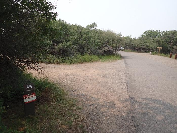 View of parking area for Campsite A-005