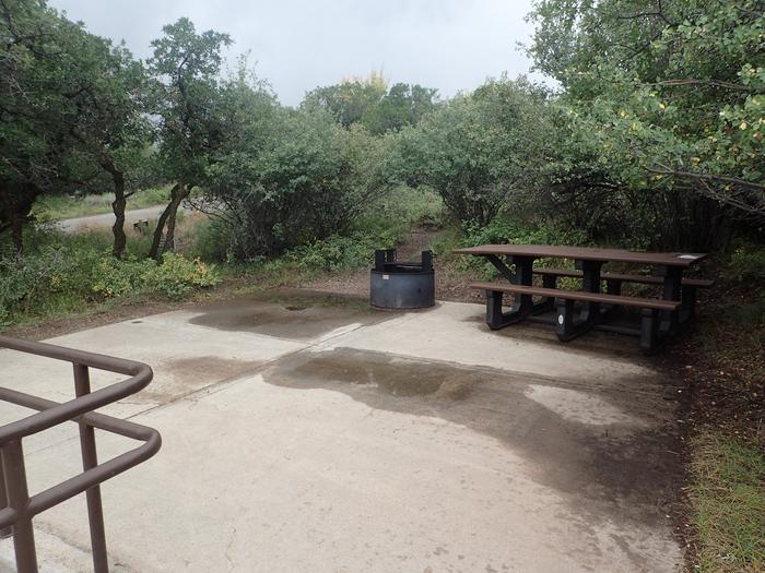 View of living space within Campsite B-001 after rainstorm
