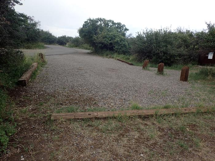 View of parking area for Campsite A-012 looking towards road