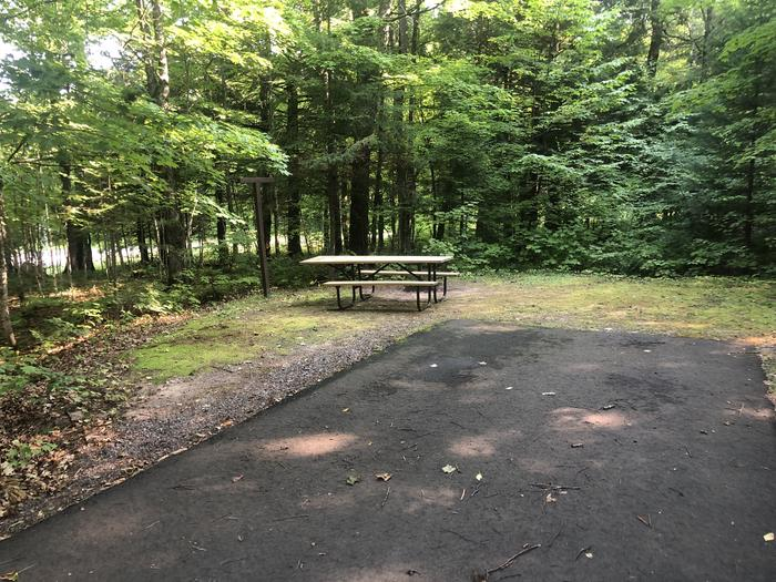 A photo of Site 001 of Loop 1 at Sylvania (Clark Lake) Campground with Picnic Table, Fire Pit, Lantern Pole