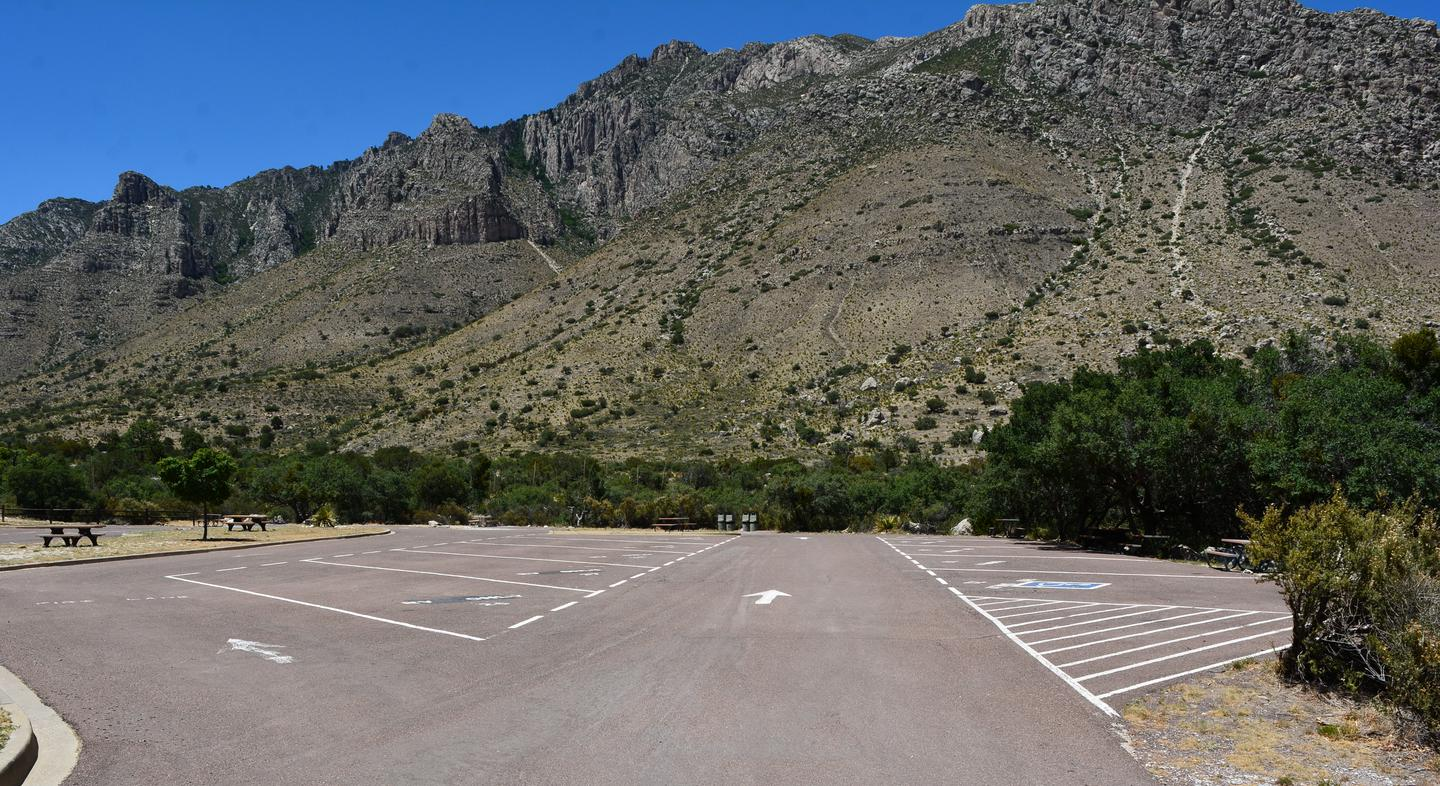 This is a view of the area surrounding RV Site 27.  This is an open, paved parking lot with painted lines to delineate each campsite.RV Site 27 is to the left of this drive.  It is the second in a row of five pull-through sites.