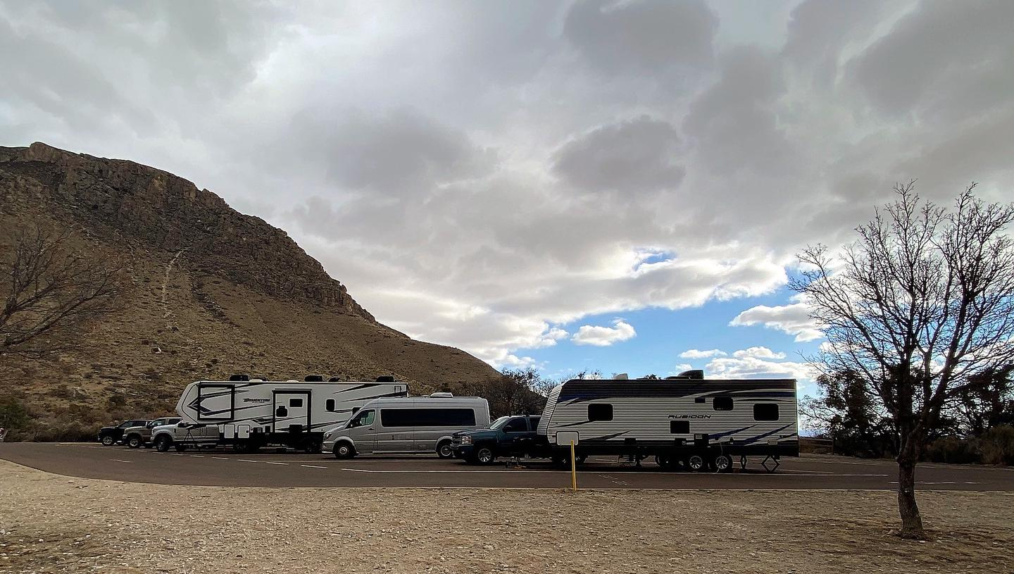 Overview of RV sites 26-30.  The sites are occupied RV's, trailers and camper vans.Overview of RV sites 26-30.
