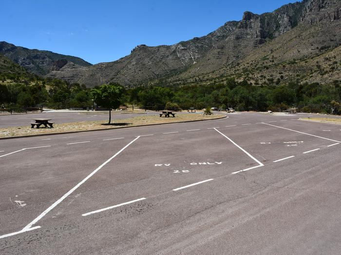 RV Campsite 28 is a paved, pull-through site separated from neighboring sites by painted lines on the pavement.  The area is surrounded by views of the Guadalupe Mountains.RV Campsite 28 is a paved, pull-through site.