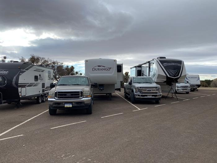 This photo shows both campsites RV 28 & 29.  They are occupied by 5th Wheel trailers and trucks.  The photo demonstrates how limited they are on space.This photo shows both campsites RV 28 & 29.  Spacing is very limited, as shown here.
