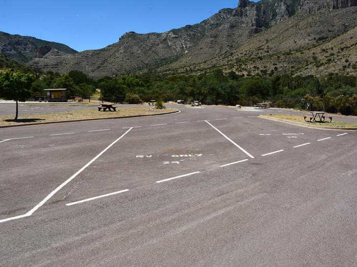 RV Campsite 29 is a paved, pull-through site.  This paved parking space is delineated by painted markings on the pavement.  Mountain views in the background.RV Campsite 29 is a paved, pull-through site.
