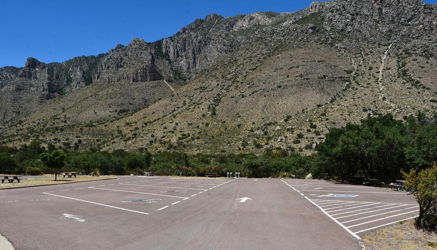 A view of RV campground parking area with sites 21-30 shown.  Site 29 is located along the left side of travel lane.  Mountain views in the background.A view of RV campground parking area with sites 21-30 shown.  Site 29 is located along the left side of travel lane.