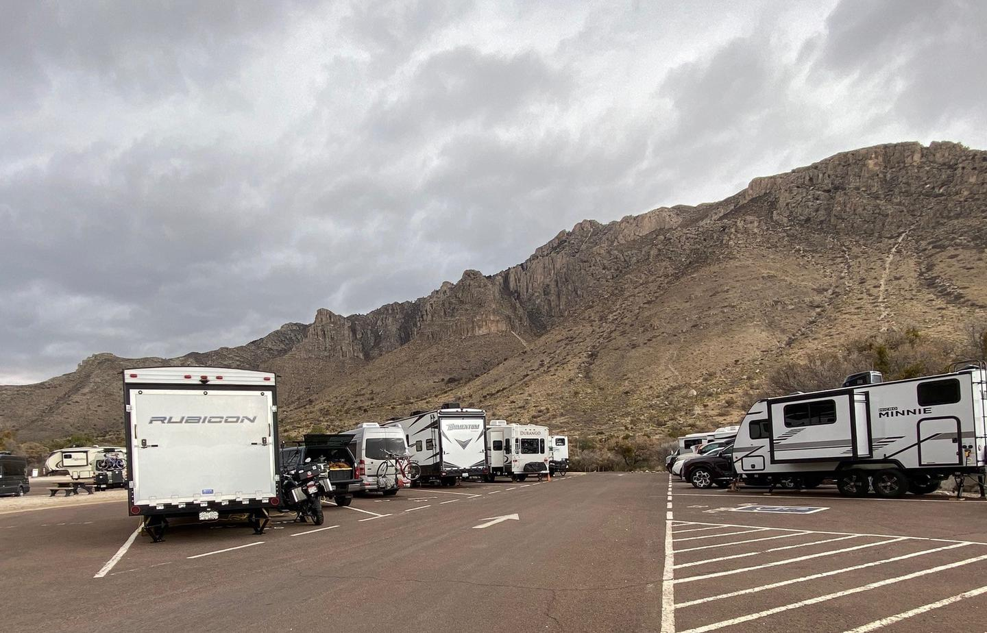Overview of RV camping, sites 21-30 when near capacity.  Vehicles are parked in tight rows with little spacing on either side.Overview of RV camping, sites 21-30 when near capacity.