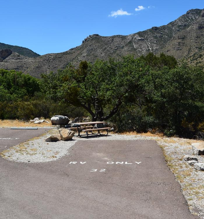 RV Campsite 32 is a paved, pull-in site.  This site offers views of the mountains and a picnic table to the left of the spur.RV Campsite 32 is a paved, pull-in site offering nice mountain views and a picnic table.