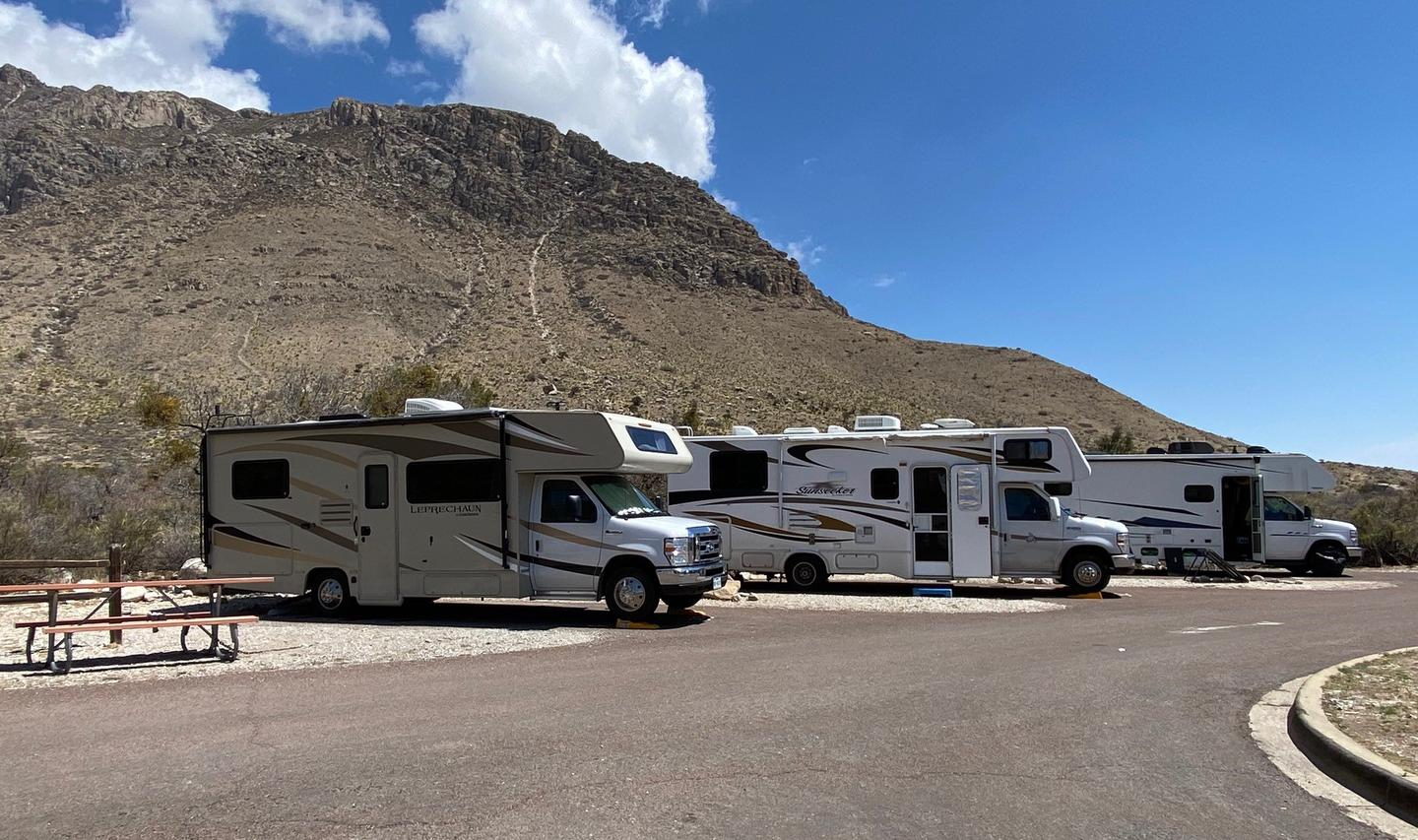 RV Campsites 31, 32 and 33 are occupied by RVs in this photo.  These short, paved, pull-in site limit vehicle size.  RV Campsites 31, 32 and 33.  Site 33 is to the left side of the photo.