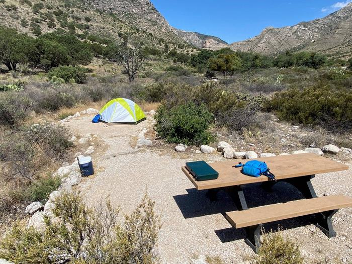 Campsite number five, shown with 2-person tent and mountains in the background.