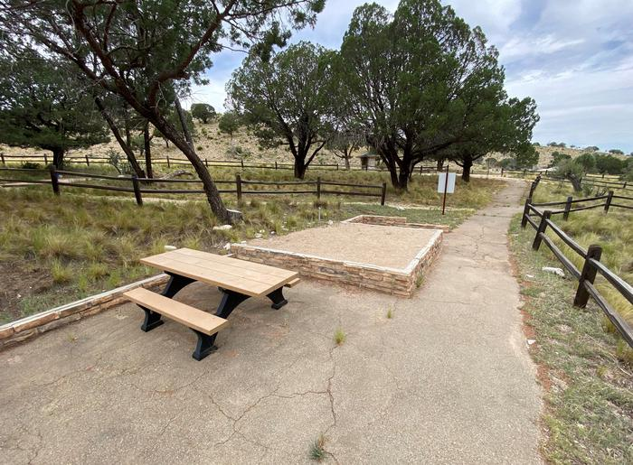 Tent campsite #7 is a hike-in site.  The distance from the parking area is approximately 93' along a paved path.Accessible campsite #7 is a hike-in site.  Via a paved pathway there is access to parking, approximately 93 feet away and the restroom is 130 feet away.
