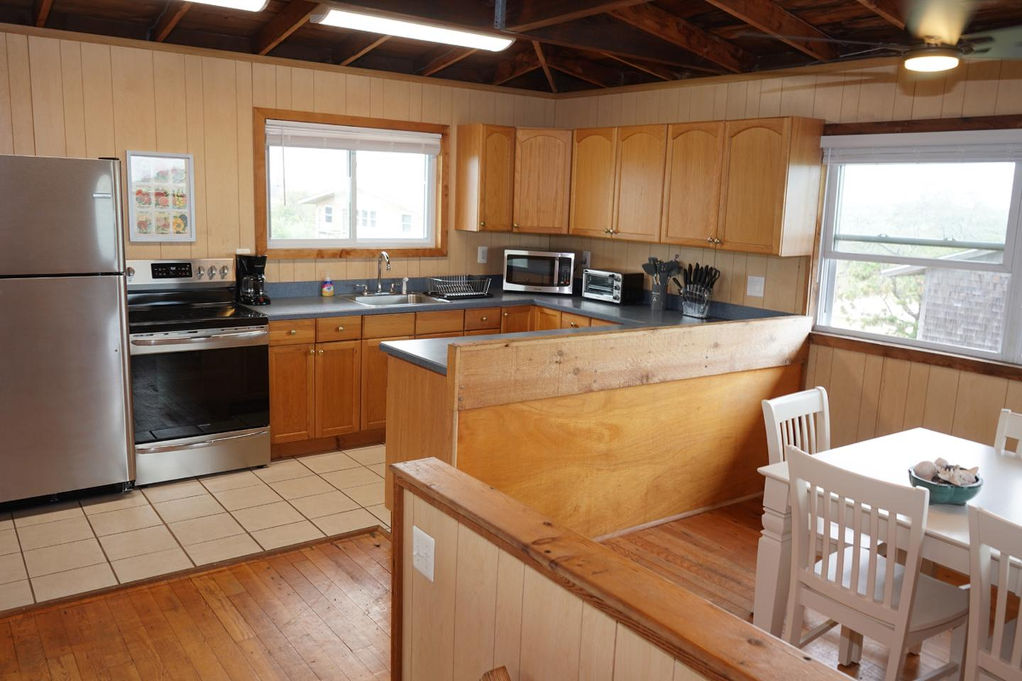 A fully furnished kitchen at a beach house.Fully furnished kitchen.