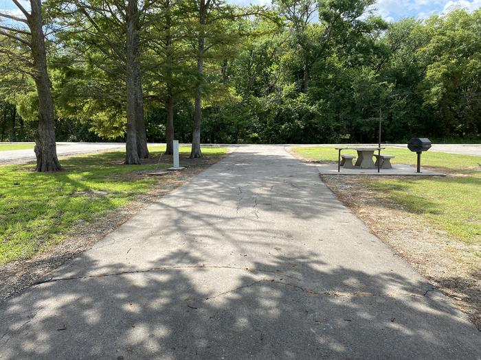A photo of Site 05 of Loop CCRE at CANNING CREEK with Picnic Table, Electricity Hookup, Fire Pit, Shade, Waterfront, Water Hookup
