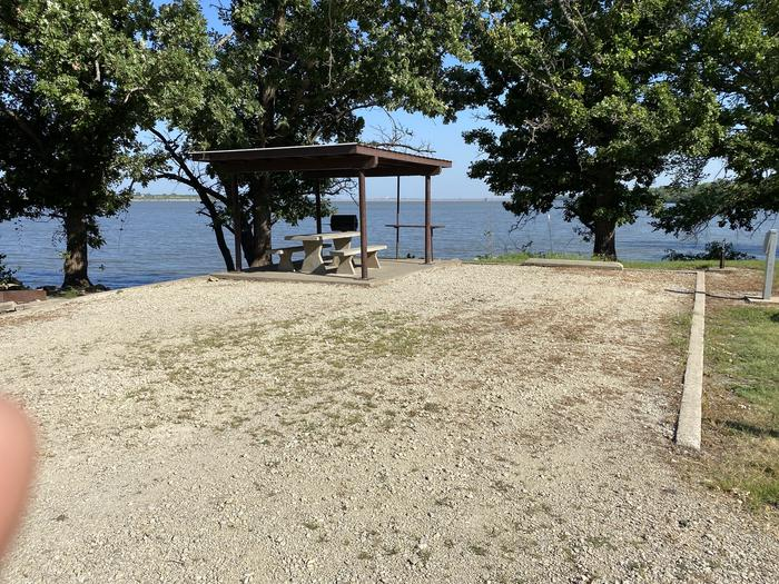 A photo of Site 07 of Loop CCRE at CANNING CREEK with Picnic Table, Electricity Hookup, Fire Pit, Shade, Waterfront, Water Hookup