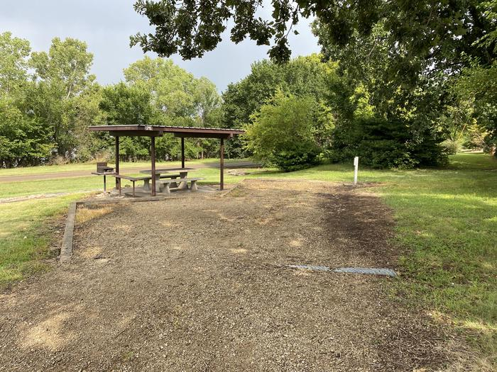 A photo of Site 26 of Loop CCRE at CANNING CREEK with Picnic Table, Electricity Hookup, Fire Pit, Shade, Waterfront
