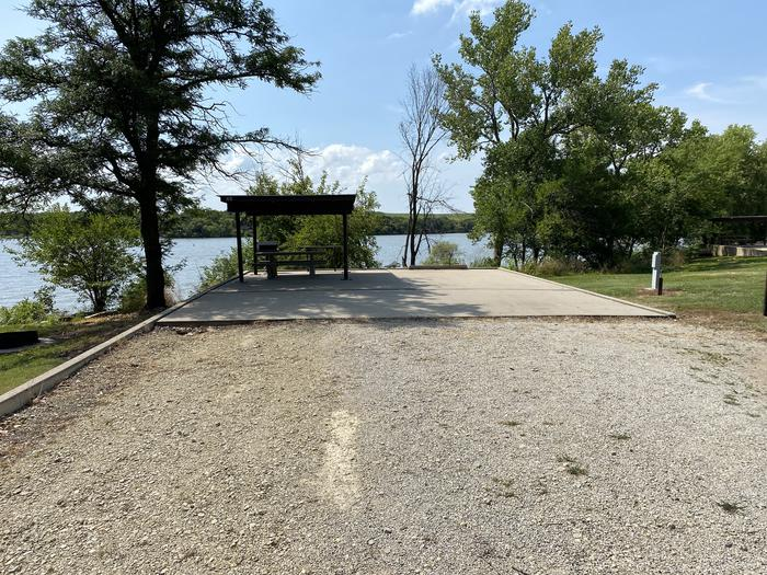 A photo of Site 45 of Loop CCRE at CANNING CREEK with Picnic Table, Electricity Hookup, Fire Pit, Shade, Waterfront, Water Hookup