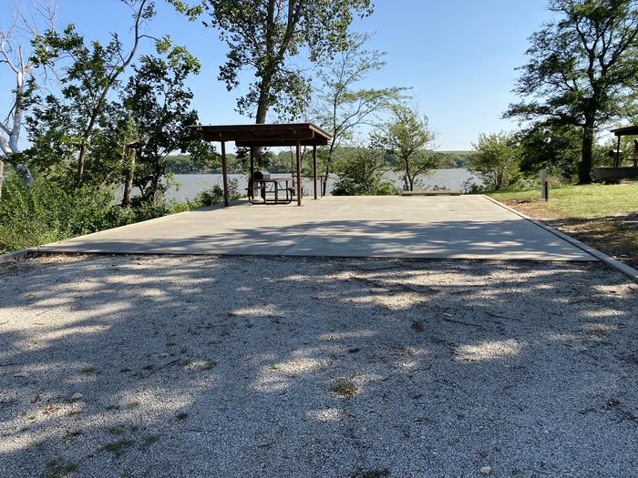 A photo of Site 44 of Loop CCRE at CANNING CREEK with Picnic Table, Electricity Hookup, Fire Pit, Shade, Waterfront, Water Hookup