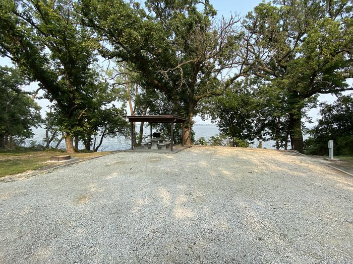 A photo of Site 09 of Loop CCRE at CANNING CREEK with Picnic Table, Electricity Hookup, Fire Pit, Shade, Waterfront, Water Hookup