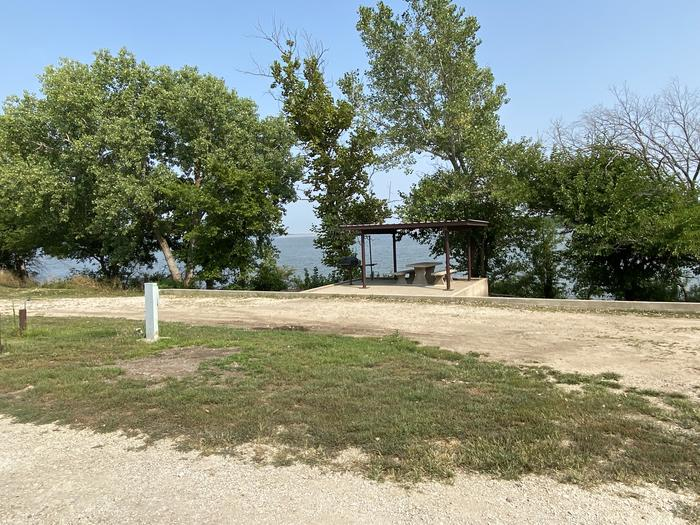 A photo of Site 47 of Loop CCRE at CANNING CREEK with Boat Ramp, Picnic Table, Electricity Hookup, Fire Pit, Shade, Waterfront, Water Hookup
