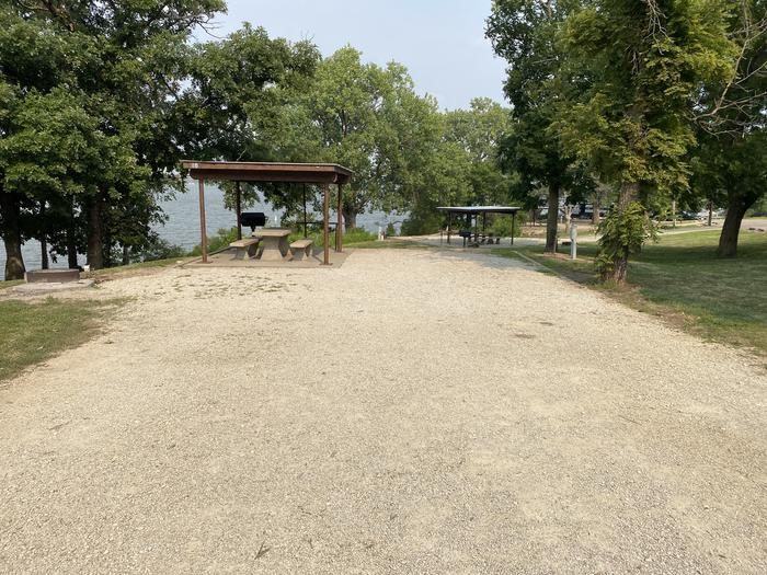 A photo of Site 18 of Loop CCRE at CANNING CREEK with Picnic Table, Electricity Hookup, Fire Pit, Shade, Waterfront, Water Hookup
