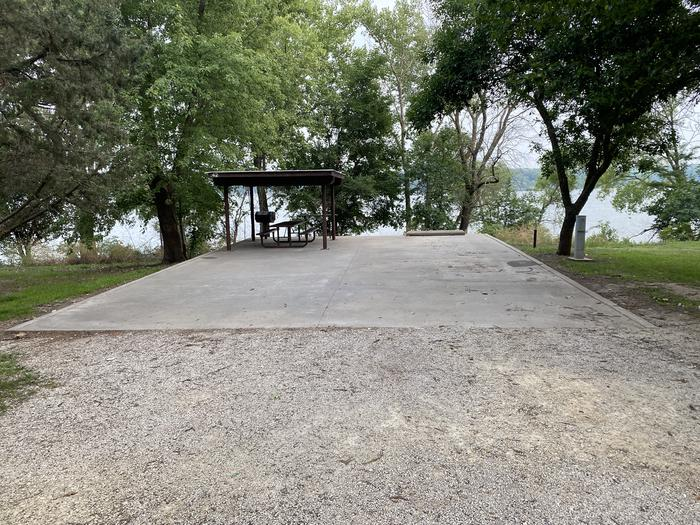 A photo of Site 42 of Loop CCRE at CANNING CREEK with Picnic Table, Electricity Hookup, Fire Pit, Shade, Waterfront, Water Hookup