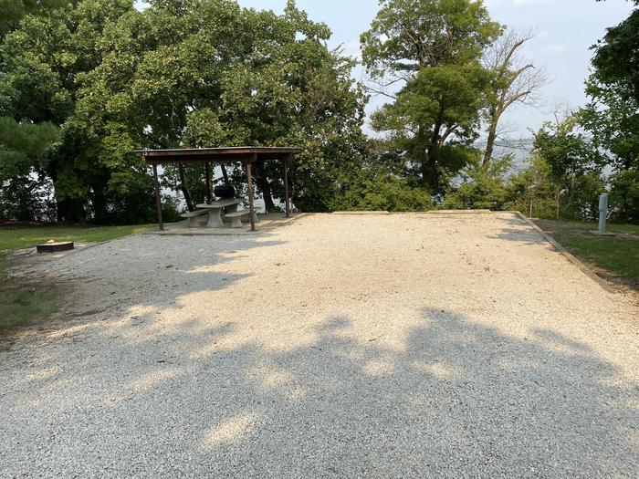 A photo of Site 13 of Loop CCRE at CANNING CREEK with Picnic Table, Electricity Hookup, Fire Pit, Shade, Waterfront, Water Hookup