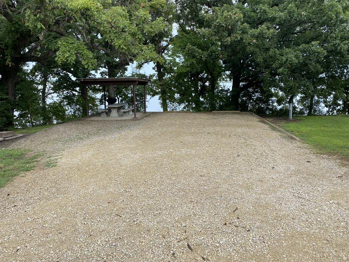 A photo of Site 12 of Loop CCRE at CANNING CREEK with Picnic Table, Electricity Hookup, Fire Pit, Shade, Waterfront, Water Hookup