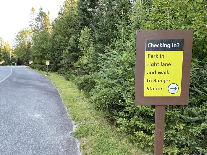 Camper check in sign stating- park in right lane and walk to ranger stationCamper check in sign stating- park in right lane and walk to Ranger Station. Don't forget your ID, park pass and license plate number!
