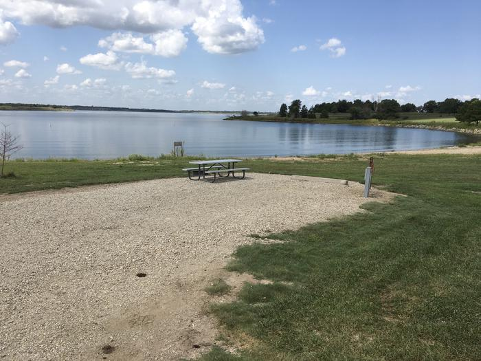 A photo of Site A-001 of Loop A at WEST ROLLING HILLS with Picnic Table, Electricity Hookup, Fire Pit, Waterfront, Water Hookup