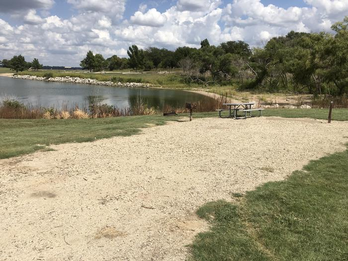 A photo of Site A-021 of Loop A at WEST ROLLING HILLS with Picnic Table, Fire Pit, Waterfront