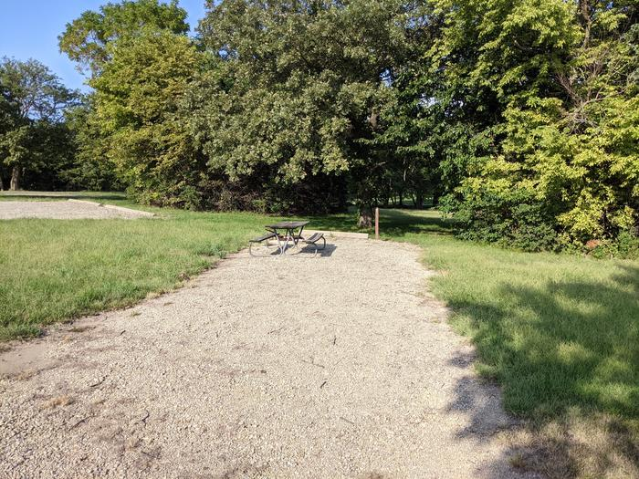 A photo of Site 10 of Loop A at Timber Creek Park with Fire Pit, Water Hookup
