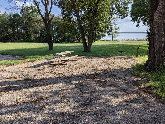 A photo of Site 21 of Loop A at Timber Creek Park with Picnic Table, Fire Pit, Shade, Waterfront