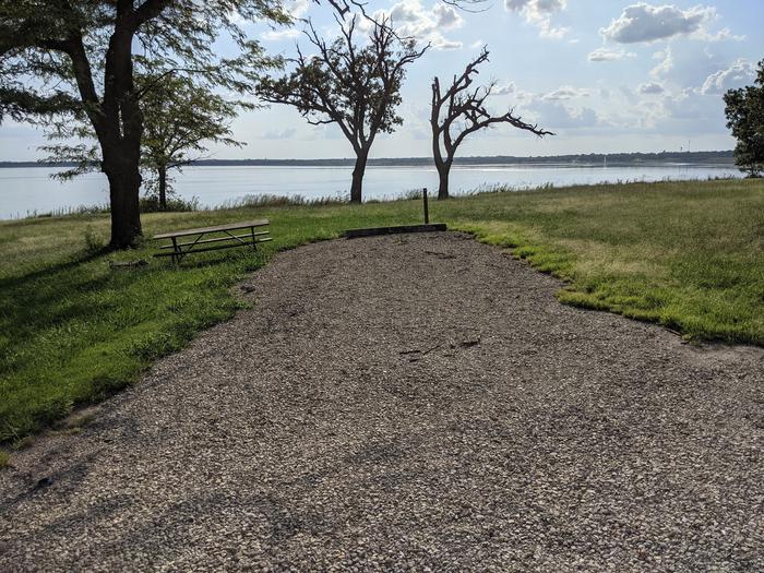 A photo of Site 19 of Loop A at Timber Creek Park with Picnic Table, Fire Pit, Shade