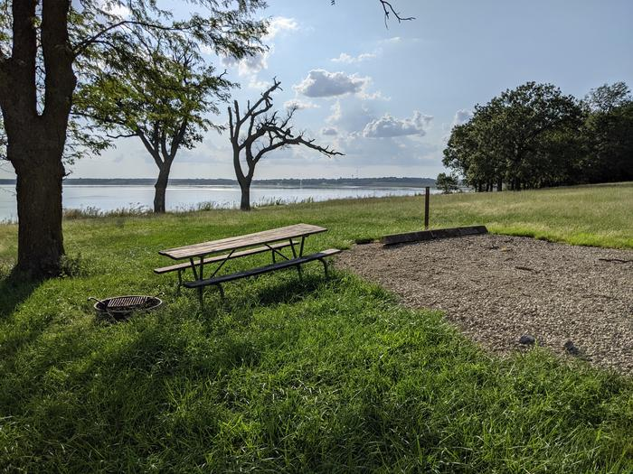 A photo of Site 19 of Loop A at Timber Creek Park with Picnic Table, Fire Pit, Shade, Waterfront