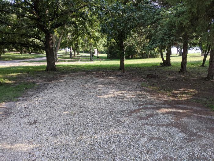 A photo of Site 6 of Loop A at Timber Creek Park with Picnic Table, Fire Pit, Shade