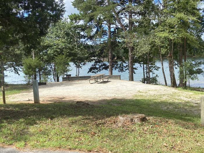 A photo of Site 15 of Loop SPRINGFIELD  at SPRINGFIELD with Picnic Table, Electricity Hookup, Fire Pit, Shade, Tent Pad, Lantern Pole, Water Hookup