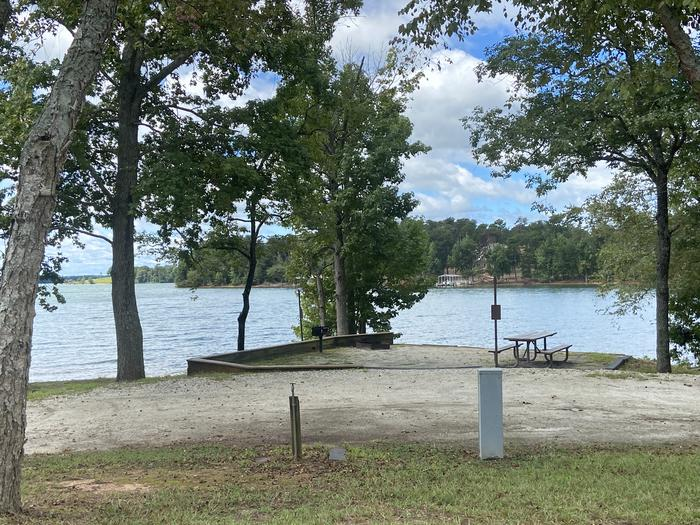 A photo of Site 13 of Loop SPRINGFIELD  at SPRINGFIELD with Picnic Table, Electricity Hookup, Fire Pit, Shade, Tent Pad, Waterfront, Lantern Pole, Water Hookup