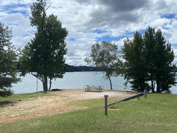 A photo of Site 36 of Loop SPRINGFIELD  at SPRINGFIELD with Picnic Table, Electricity Hookup, Fire Pit, Shade, Tent Pad, Waterfront, Lantern Pole, Water Hookup