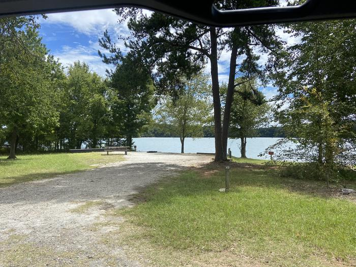 A photo of Site 43 of Loop SPRINGFIELD  at SPRINGFIELD with Picnic Table, Electricity Hookup, Fire Pit, Shade, Tent Pad, Waterfront, Lantern Pole, Water Hookup
