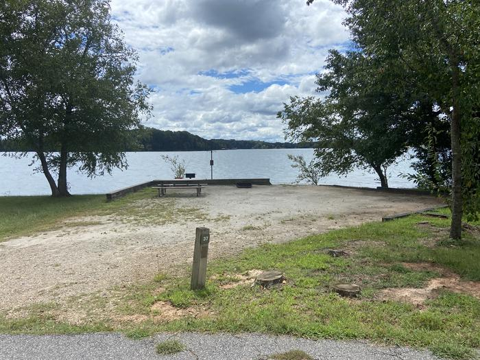 A photo of Site 37 of Loop SPRINGFIELD  at SPRINGFIELD with Picnic Table, Electricity Hookup, Fire Pit, Shade, Tent Pad, Waterfront, Lantern Pole, Water Hookup