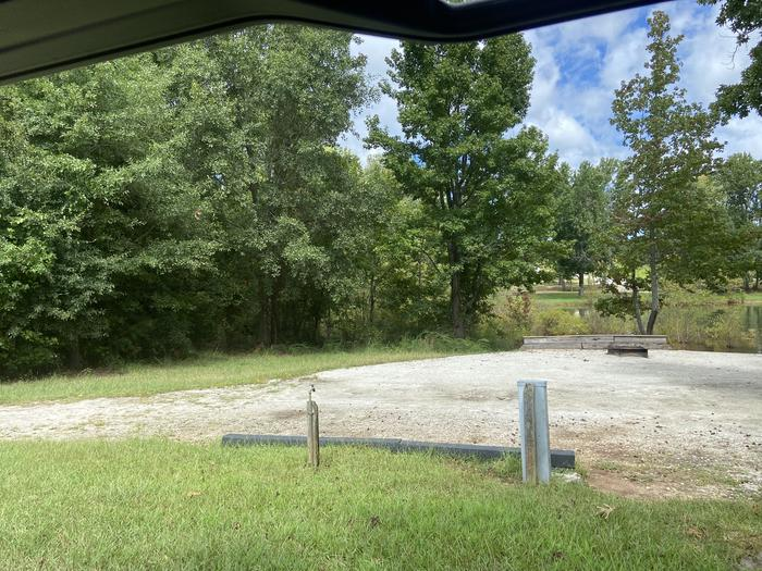 A photo of Site 46 of Loop SPRINGFIELD  at SPRINGFIELD with Picnic Table, Electricity Hookup, Fire Pit, Shade, Tent Pad, Waterfront, Lantern Pole, Water Hookup